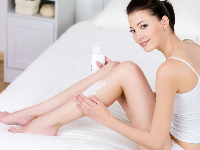 woman-applying-body-lotion-on-her-legs-6-Tips-For-a-Perfect-Skin