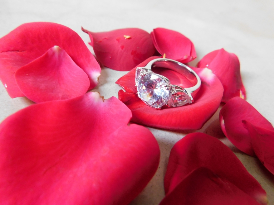 three stone solitaire ring