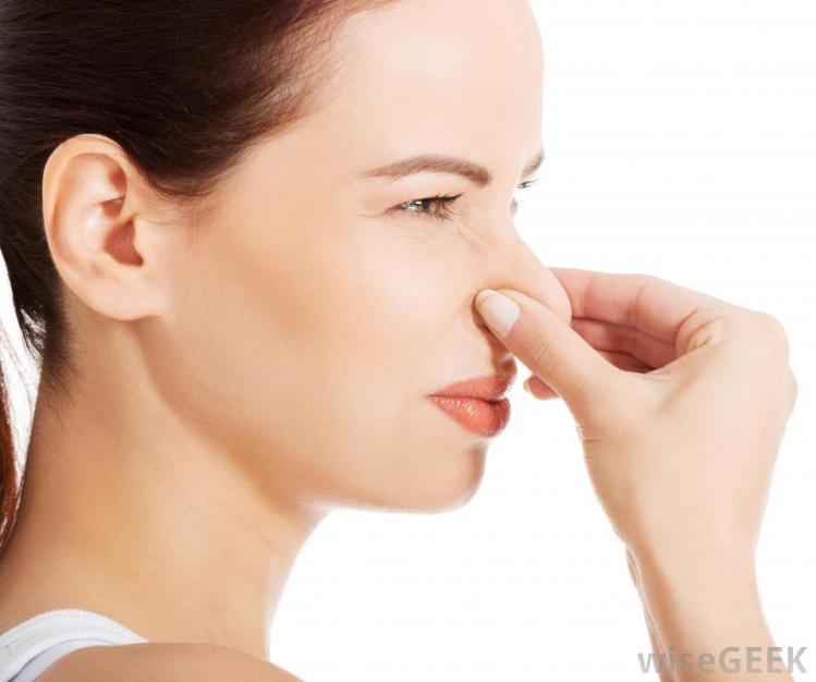 side-view-of-woman-plugging-her-nose