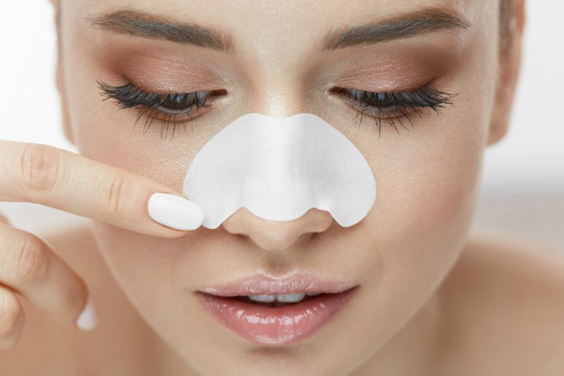 Beauty-Skin-Care.-Beautiful-Sexy-Girl-Applying-White-Nose-Patch-On-Facial-Skin.-1.jpg