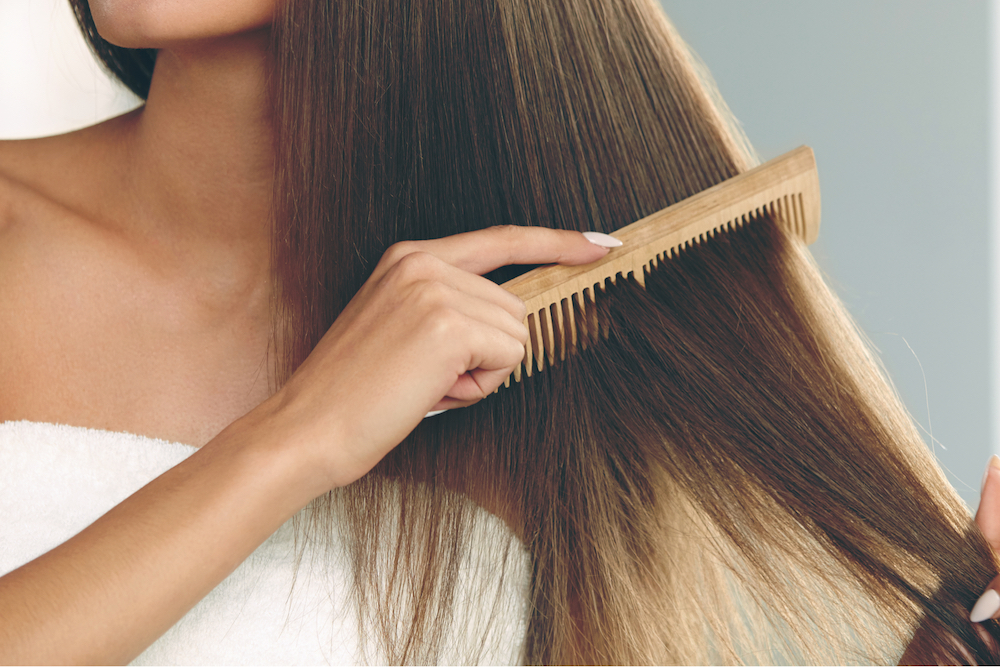 Brushing-Hair.-Portrait-Of-Sexy-Young-Woman-Brushing-Straight-Natural-Hair-With-Comb.jpg