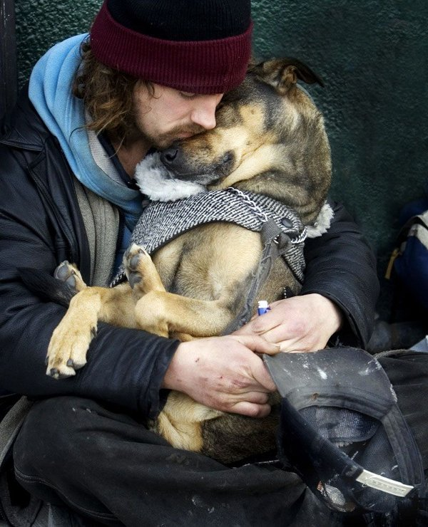 homeless-man-cuddling-with-a-dog.jpg